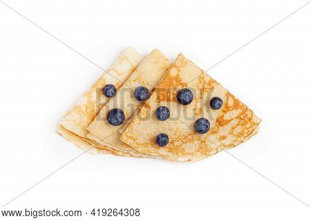 Pancakes Isolated On White Background. Many Pancakes Rolled Into A Triangle Thin Pancakes With Crisp