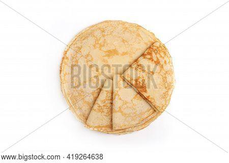 Pancake On The White Plate. Many Pancakes Are Stacked. Thin Pancakes With Crispy Crust. Maslenitsa.