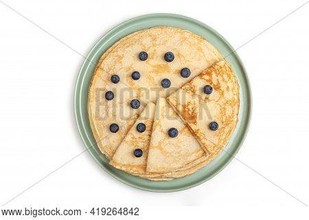 Pancake On The Green Plate On White Background. Many Pancakes Are Stacked. Thin Pancakes With Crispy