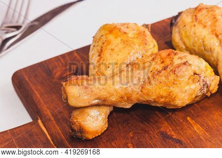 Fried Crispy Chicken Legs, Thigh Wooden Cutting Board With Spice On Table