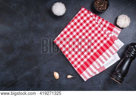 Napkin On Black Stone Background And Spice, Pepper, Salt. Cooking Food Background For Menu In Rusric