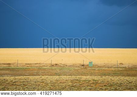 Grasslands On A Windswept Prairie With Thunderstorms And Dark Rain Clouds Beyond Taken In The Easter
