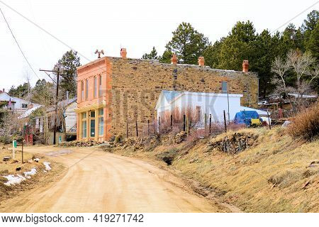 April 25, 2021 In Russell Gulch, Co:  Main Road With Vintage Buildings Surrounded By An Alpine Pine