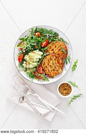 Grilled Chicken Burgers, Avocado And Fresh Vegetable Salad With Tomato And Arugula, Top View