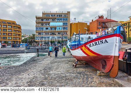 Puerto de la Cruz, Tenerife,  Spain - December 13, 2019: Waterftont with walking people in Puerto de la Cruz , The Canaries