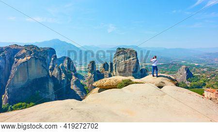 Meteora,  Greece - September 17, 2019: Man taking photo  at panoramic view point at Meteora
