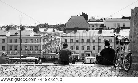 Helsinki, Finland - July 26, 2017: Senate Square in Helsinki and resting people on the stairs. Black and white photography