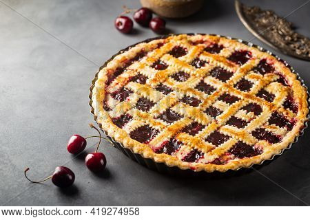 Delicious Homemade Classic Cherry Pie With A Flaky Crust On Dark Gray Background