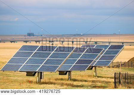 Solar Panels Absorbing Sunlight And Transfering It To Green Alternative Energy Taken On A Ranch At A