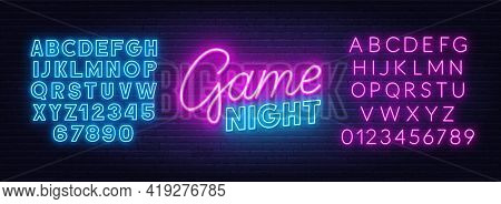 Game Night Neon Sign On Brick Wall Background. Neon Blue And Pink Alphabet.