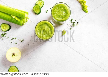 Green Vegetable Juice Or Smoothie In Glasses. Fresh Squeezed Detox Green Juice And Bunch Of Organic