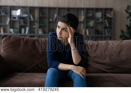 Thoughtful Unhappy Indian Woman Lost In Thoughts, Looking To Aside