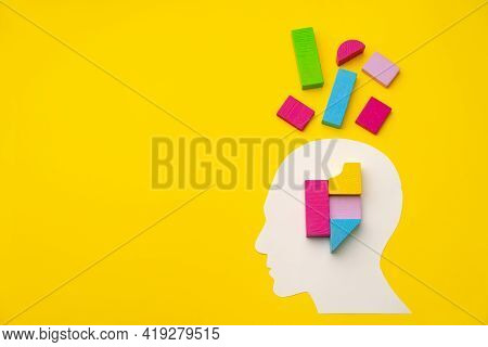 Papercut Head Silhouette With Toy Constructor Pieces On Yellow Background