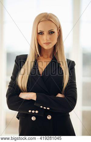 Posh Confident Blonde Woman In Black Jacket.