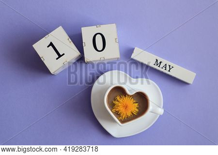 Calendar For May 10: Cubes With The Number 10, The Name Of The Month Of May In English, A Cup Of Cof