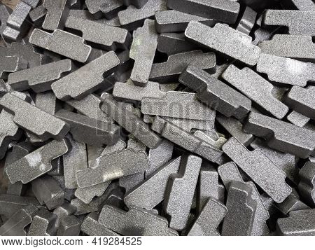 Heap Of Gray Steel Forgings After Shot Blasting - Close-up Natural Heavy Industrial Pattern With Sel
