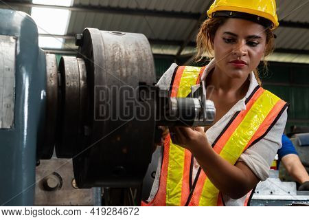 Skillful Factory Woman Worker Do Machine Job In Manufacturing Workshop . Industrial People And Manuf