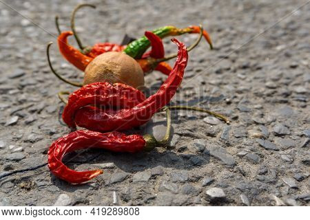 Lemon Chilli Bundle On The Street. An Old Practice Of Throwing Lemon And Chilli Bundle As A Part Of