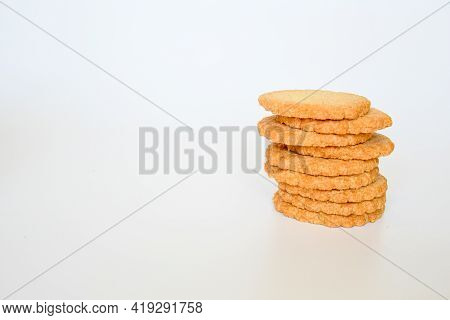 Stack Of Biscuit Or Cookie On White Background. Biscuit A Flour-based Baked Food Product ,sweet And