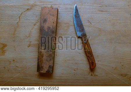 An Old Homemade Knife And A Whetstone. Sharpen A Knife With A Sharpening Stone. Top.