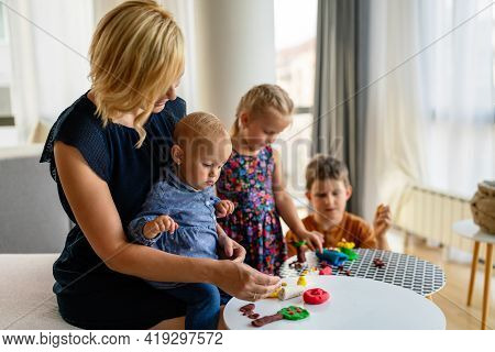 Happy Child Kids Group Have Fun And Play At Kindergarden