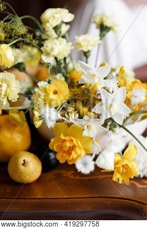 A Delicate Composition With Yellow Flowers And Fruits, With Wedding Invitations. Wedding Decor In Tr