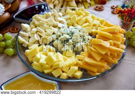 Plate With Pieces Of Various Cheeses. Close-up, Selective Focus