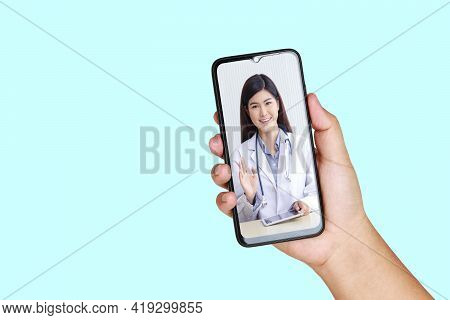 Online Doctor Concept Monitor Patient Health Through A Black Smartphone Connected To Communication V
