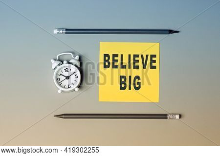 Believe Big - Text On Sticky Note Paper. Closeup Of A Personal Agenda. Top View. Conceptual Photo