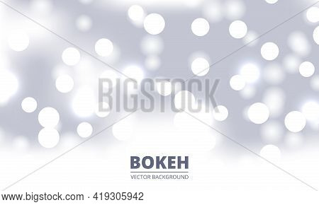 White And Silver Bokeh Background. Holiday Glowing Silver Lights With Sparkles. Festive Defocused Li