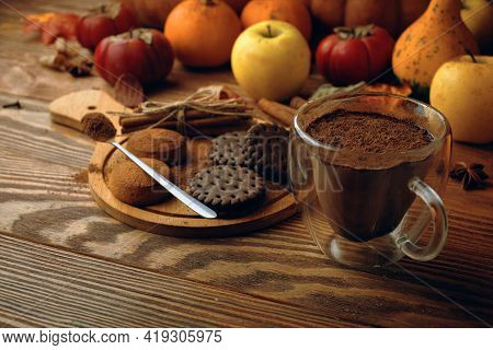 Mug Of Cocoa Chocolate Cookies And Cinnamon Sticks On Wooden Table. Autumn Composition For Postcards