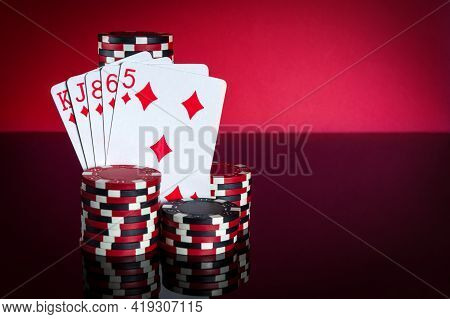 Poker Cards With Flush Combination. Close-up Of Playing Cards And Chips In Poker Club. Free Advertis