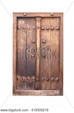 Antique closed wood door with decorative wrought iron details. Vintage wooden double door. Isolated on white background