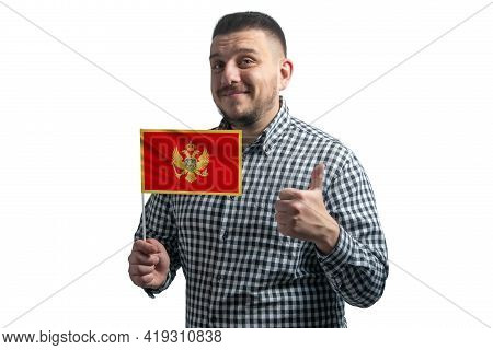 White Guy Holding A Flag Of Montenegro And Shows The Class By Hand Isolated On A White Background. L