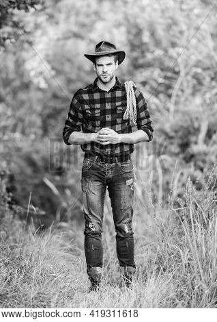 Attle Breeding Concept. Cowboy At Countryside. Ranch Occupations. Lasso Tool. American Cowboy. Lasso