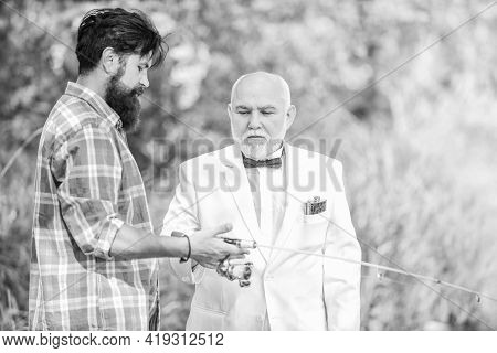 Mature Man Fisher Celebrate Retirement. Two Fishermen With Fishing Rods. Summer Family Weekend. Fath