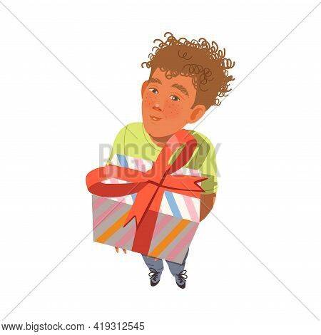 Excited Teenager Boy With Curly Hair Receiving Wrapped Gift Box For Special Occasion Like Birthday O