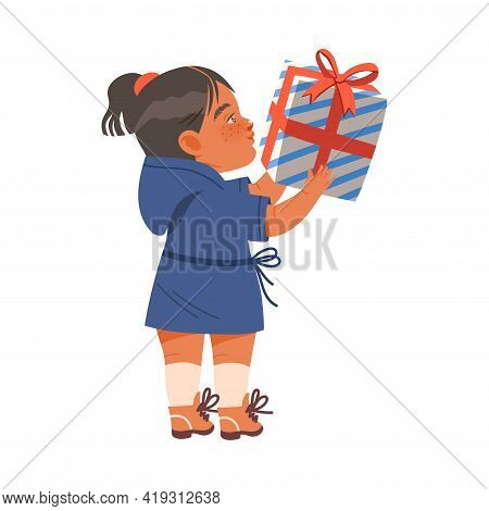 Freckled Little Girl Receiving Wrapped Gift Box For Special Occasion Like Birthday Or Holiday Celebr