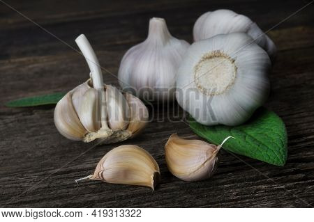 Fresh Fragrant Garlic Cloves On A Wooden Background. Vegetables Ingredients For Cooking.