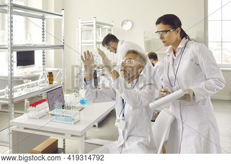 Scientist Group In Eyewear Working At Research Chemistry Medical Laboratory
