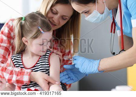Doctor Inoculates Little Girl In Shoulder Closeup