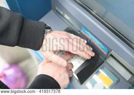 Man Enters Code On Atm Keyboard And Closes It With His Hand