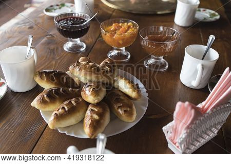 Apple Pies On A Plate Are Served With Tea And Jam. Russian Tea Time. Apple Jam Patties On A Plate. T