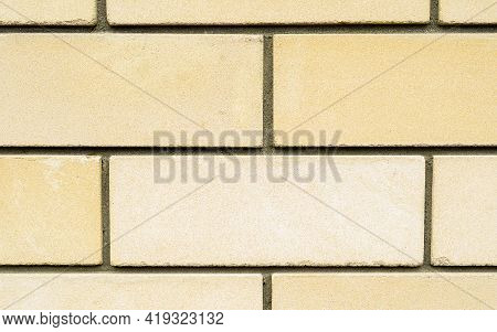 Yellow Brick Stone Wall As A Texture Background, High Resolution Building Wall Macro Image. The Text
