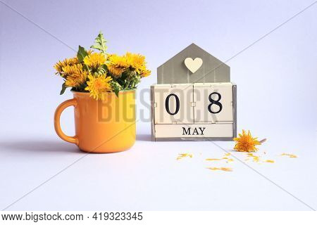 Calendar For May 8: Cubes With The Numbers 0 And 8, The Name Of The Month Of May In English, A Bouqu