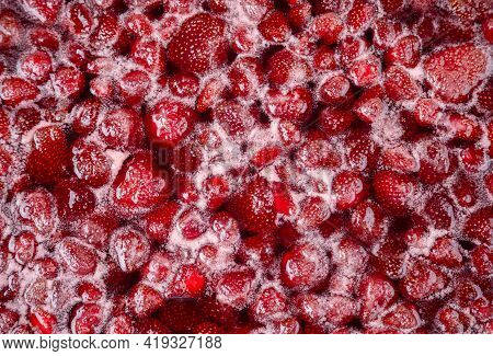 Close-up Of Strawberry Jelly Boiling In A Saucepan. Preparation Of Strawberry Jelly, Marmalade Or St