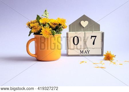 Calendar For May 7: Cubes With The Numbers 0 And 7, The Name Of The Month Of May In English, A Bouqu