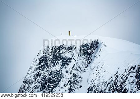 Mount Bitihorn Peak In Beitostølen Norway, Covered In Snow On A Cold Winters Day.