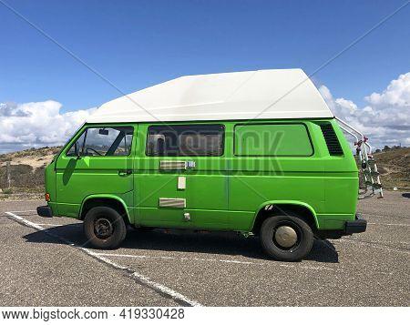 Noordwijk, The Netherland - May 2, 2021: Green Volkswagen Transporter T3 Camper Parked On A Public P