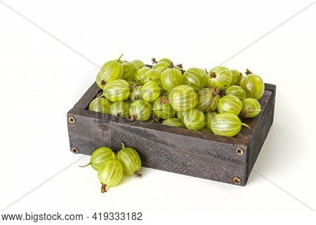 Ripe Green Gooseberry Berry In Wooden Box. Green Gooseberry Isolated On White Background